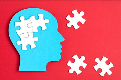 papercut head with jigsaw puzzle pieces inside men