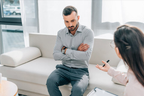 psychologist and patient talking in clinic mental