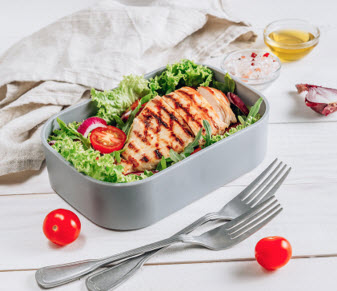 lunch boxes with chicken and salad